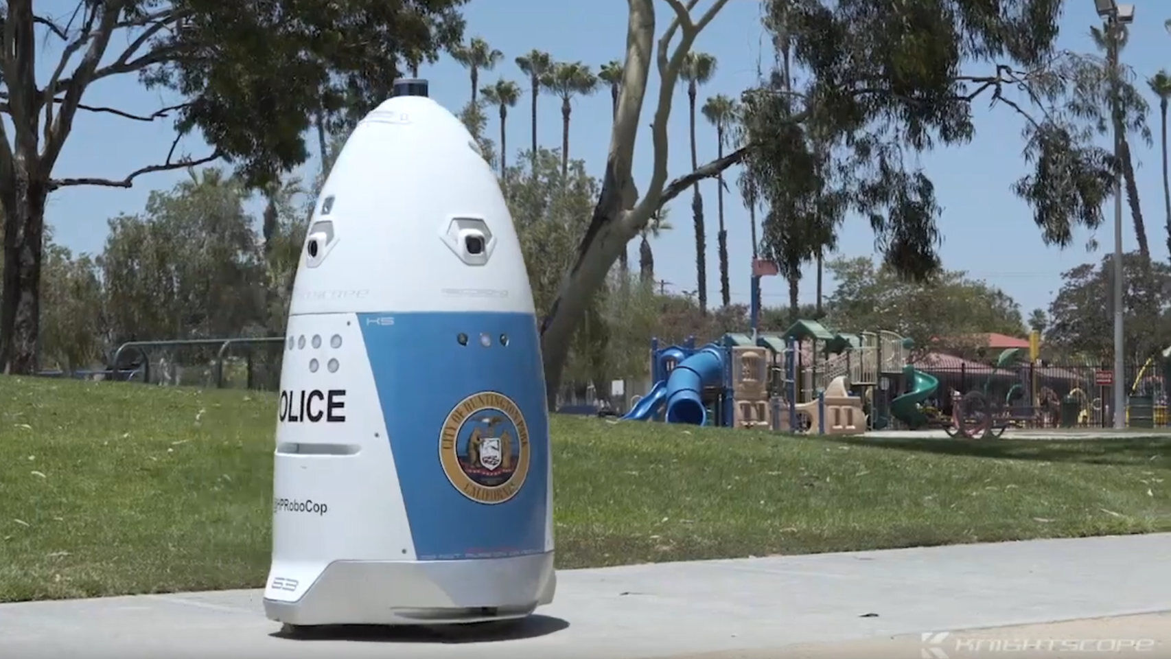 A police robot ignores distress calls because it is busy patrolling